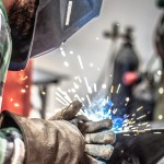 Photo of student MIG welding. Photo by Jay Dallen.